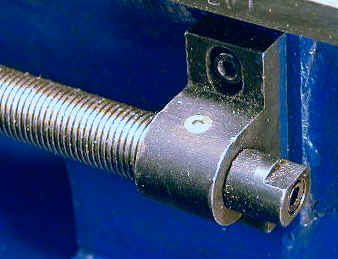 An adjustable take up nut on the right end of the lead screw allows
